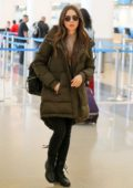 Lily Collins seen wearing a puffy jacket as she touches down at LAX Airport in Los Angeles
