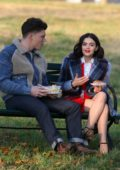 Lucy Hale and Zane holtz enjoy their lunch on Park bench while filming 'Katy Keene' at the Fort Totten Park in New York