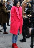 Lucy Hale looks cute in a pink fur coat while filming scenes at the 'Katy Keene' set in Long Island City in Queens, New York