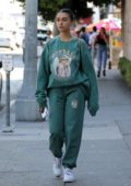 Madison Beer sports a teal green sweatsuit while shopping at a flea market with a friend in West Hollywood, Los Angeles