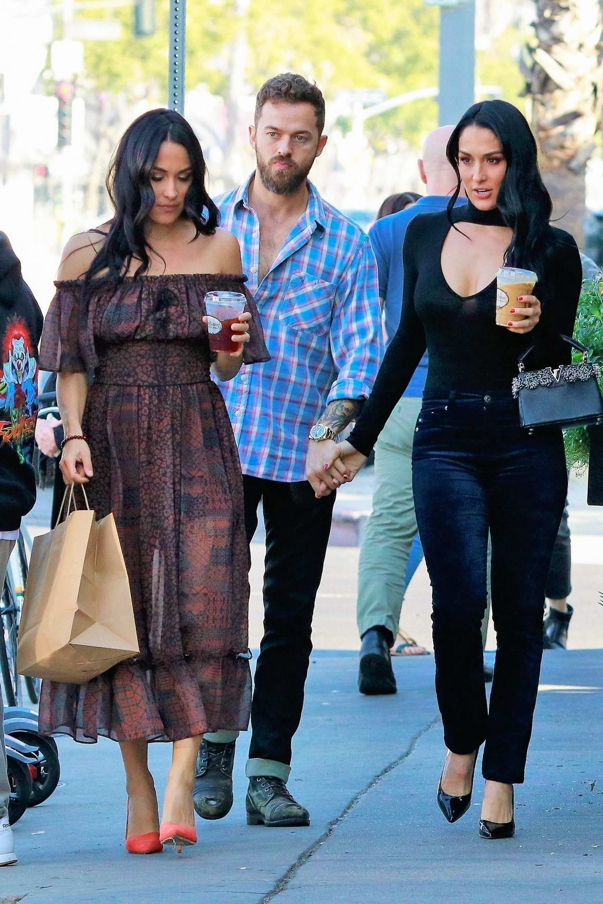 Nikki Bella, Brie Bella, and Artem Chigvintsev step out for lunch in Los Angeles