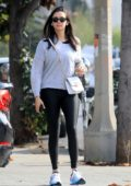 Nina Dobrev rocks a grey sweatshirt and black leggings as she steps out in West Hollywood, Los Angeles