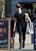 Reese Witherspoon spotted in a black top and leggings while out shopping with her son in Malibu, California