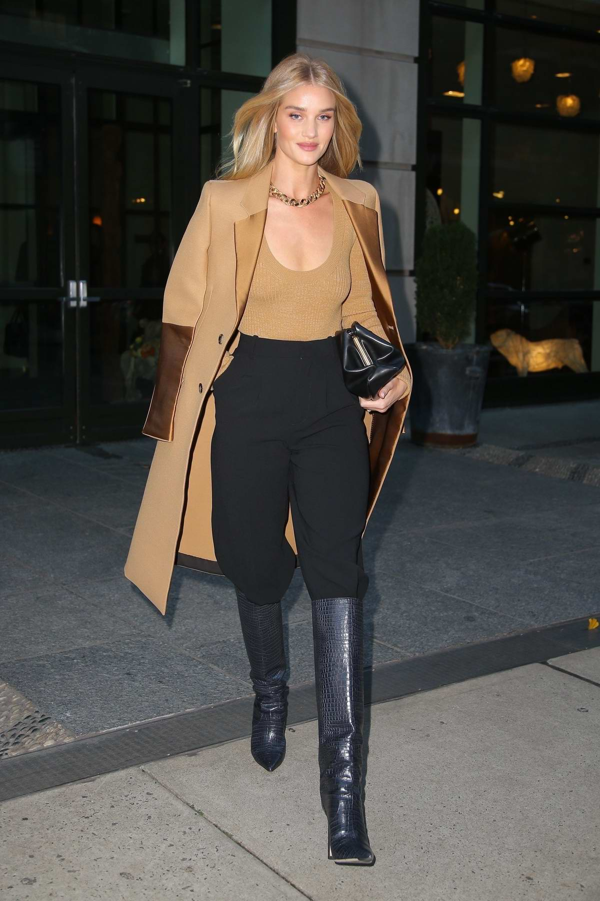 Rosie Huntinghton-Whiteley looks chic in a beige coat with matching top and black trousers as she heads out in New York City