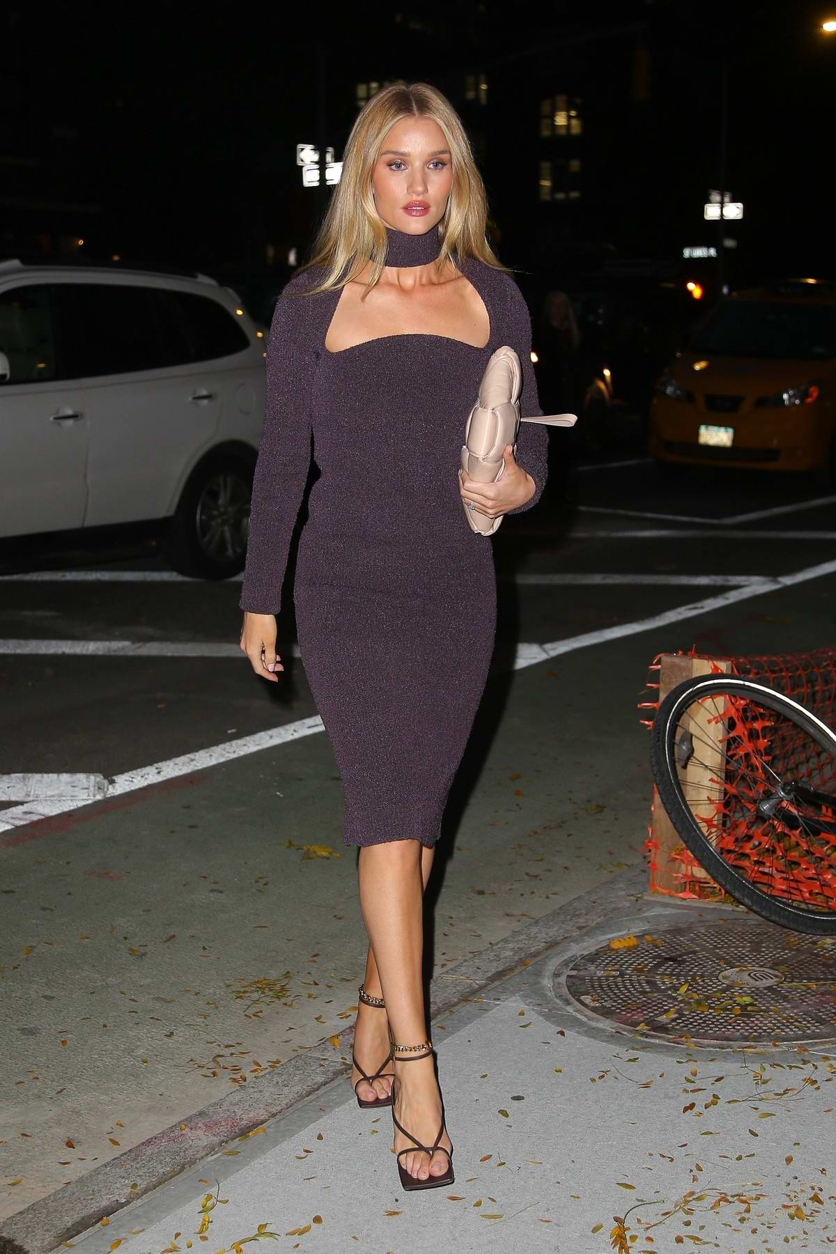 Rosie Huntington-Whiteley looks stunning in a purple dress as she leaves her hotel in New York City