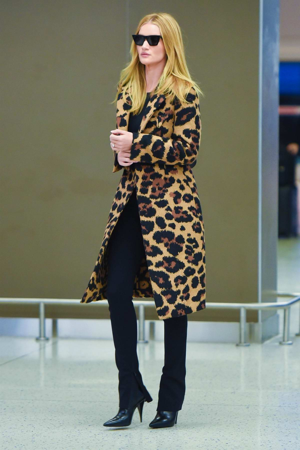 Rosie Huntington-Whiteley looks stylish in an animal print coat as she arrives at JFK Airport in New York
