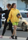 Selena Gomez stands out in bright yellow hoodie and lime green shorts while out with friends at Gelson's in Los Angeles