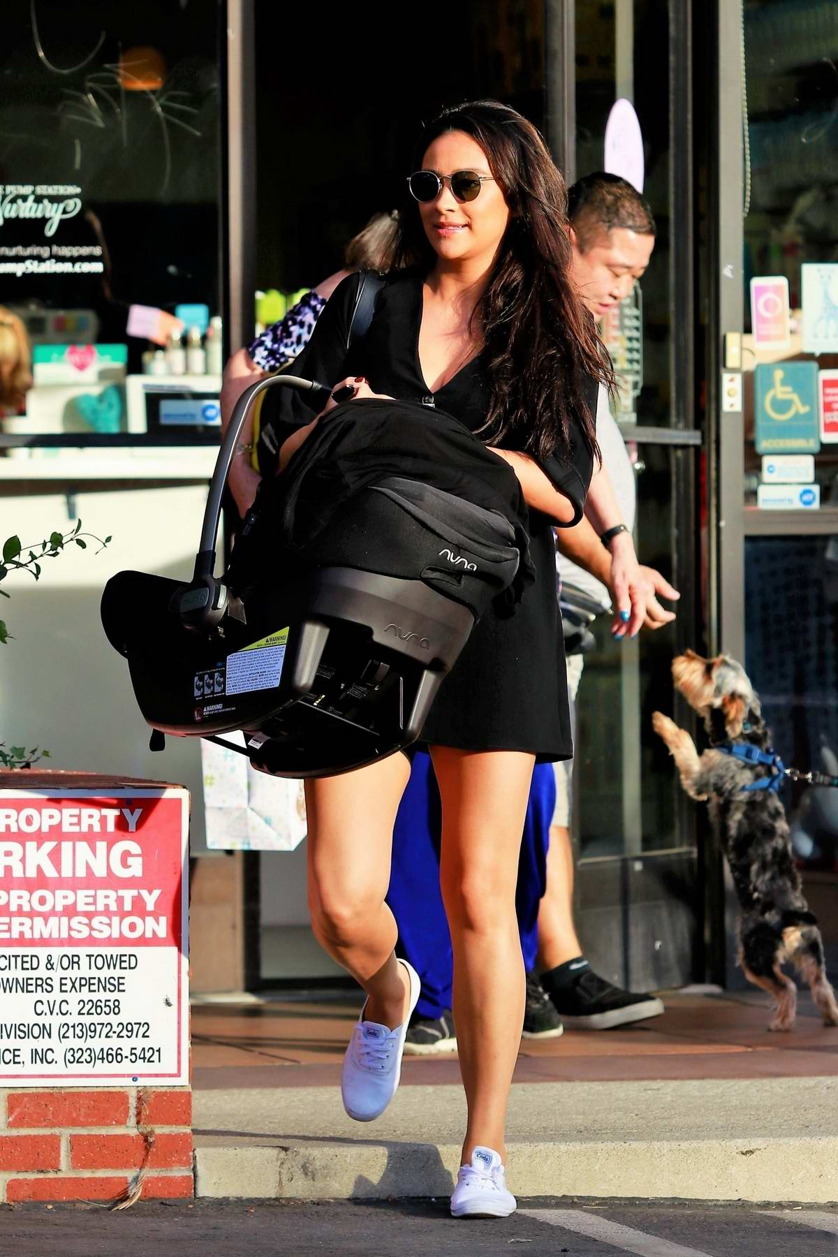 Shay Mitchell looks great in a short black dress while shopping for baby clothes in Los Angeles