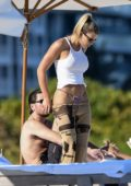 Sofia Richie and Scott Disick seen while relaxing at the beach on Thanksgiving in Miami, Florida