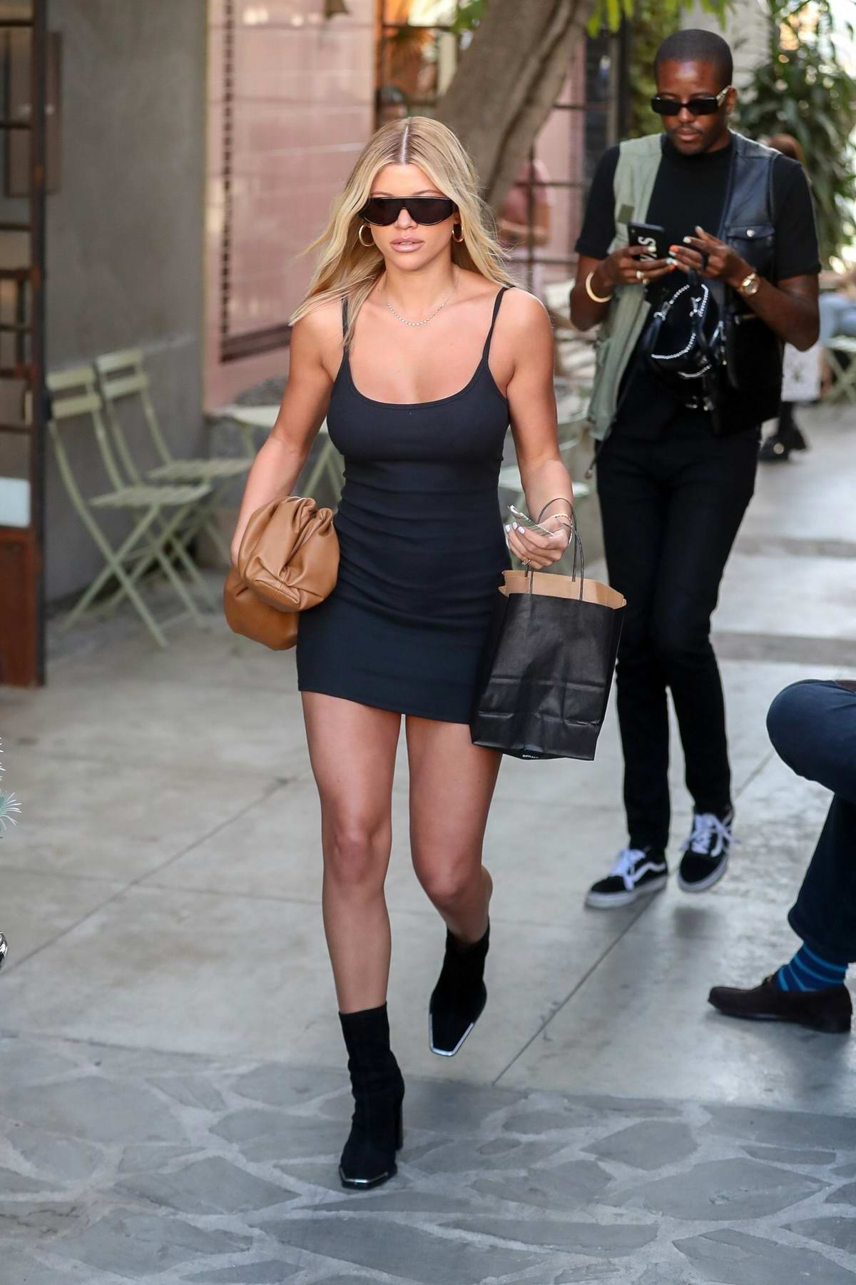 Sofia Richie looks stunning in a form-fitting black mini dress while visiting the Nine Zero One Salon in Los Angeles