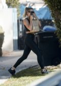 Sofia Richie wears a black crop top with matching leggings and trainers while stopping by a friend's house in West Hollywood, Los Angeles