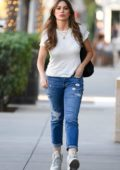 Sofia Vergara looks great in a white tee and blue jeans paired with Nike sneakers while out in Los Angeles