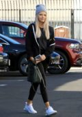 Witney Carson wears a black jacket, top and leggings while arriving for practice at the DWTS Studio in Los Angeles