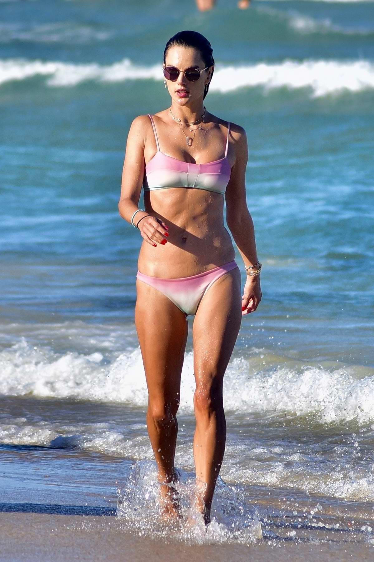 Alessandra Ambrosio looks amazing in a pink bikini as she enjoys another day at the beach in Florianópolis, Brazil