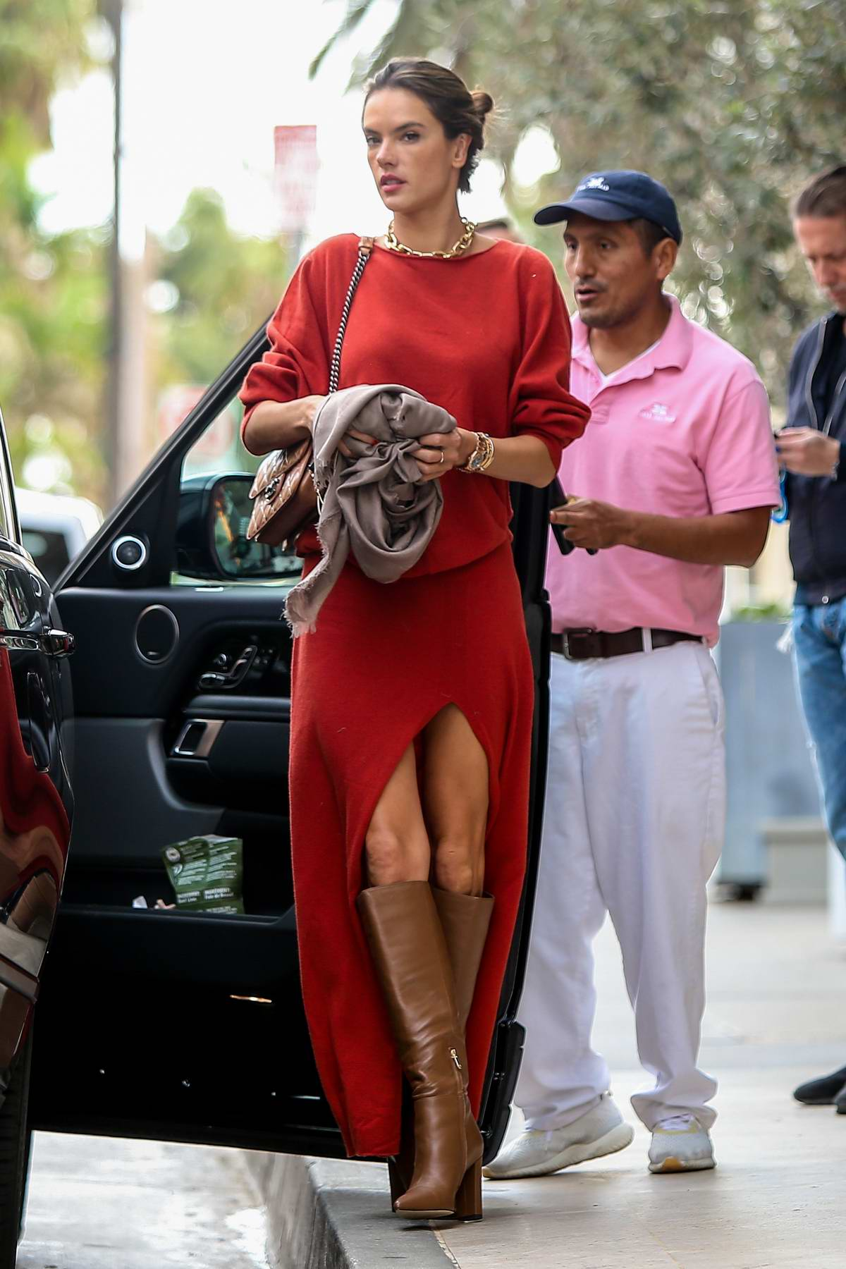 Alessandra Ambrosio looks stunning in red while stepping out for Christmas dinner at Casa Del Mar in Santa Monica, California