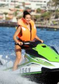 Alexandra Cane sports a green bikini as she rides the jet ski while on holiday in Tenerife, Spain