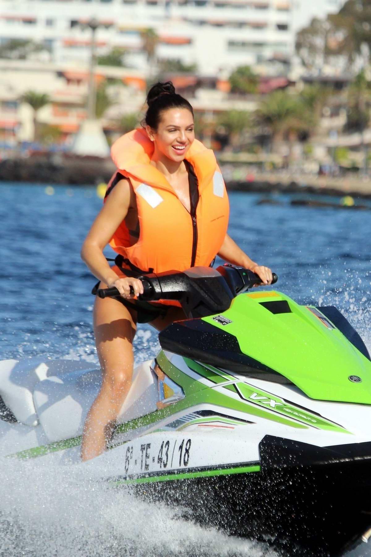 Alexandra Cane sports a green bikini as she rides the jet ski while on holiday in Tenerife, Spain
