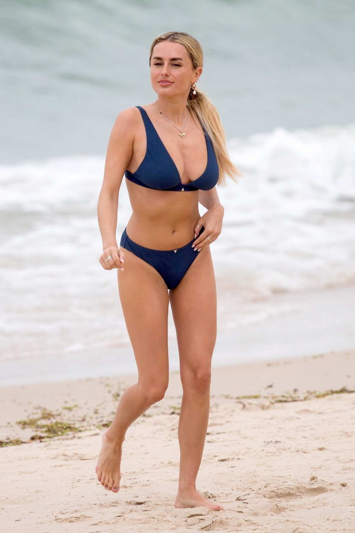 Amber Davies seen wearing a navy blue bikini at the Brighton Beach in Adelaide, Australia