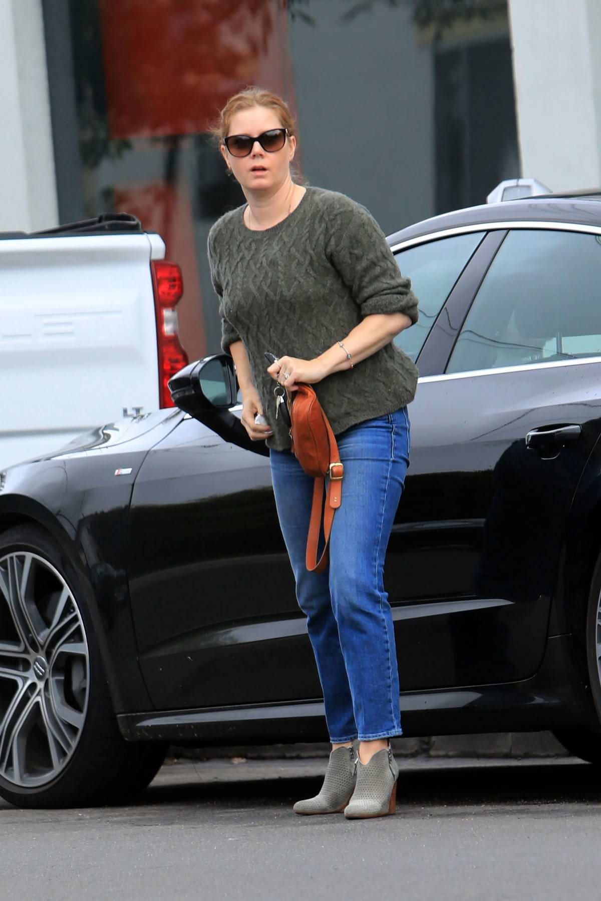 Amy Adams keeps it casual in a sweater and jeans as she steps out with her daughter in West Hollywood, Los Angeles