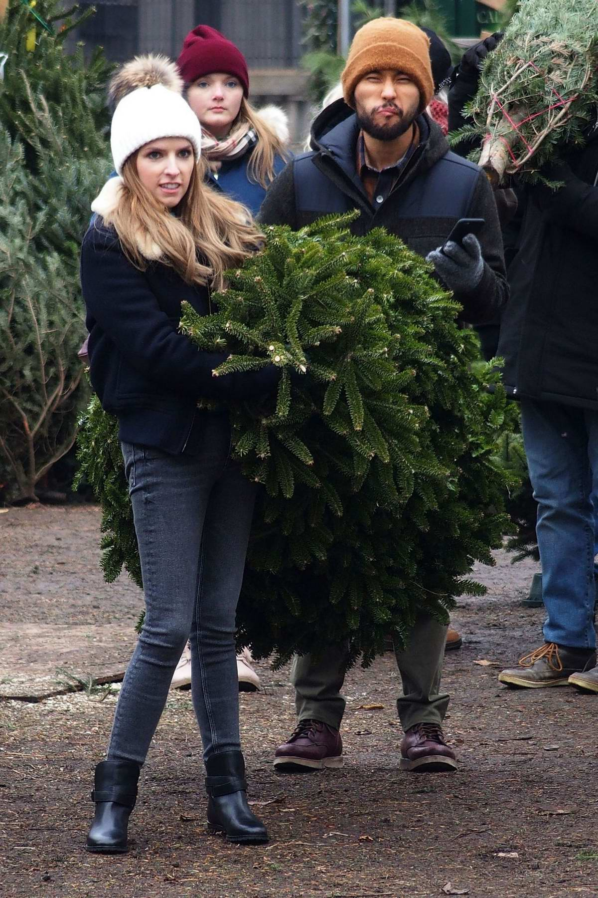 Anna Kendrick spotted carrying a Christmas Tree on the set of HBO's 'Love Life' in New York City