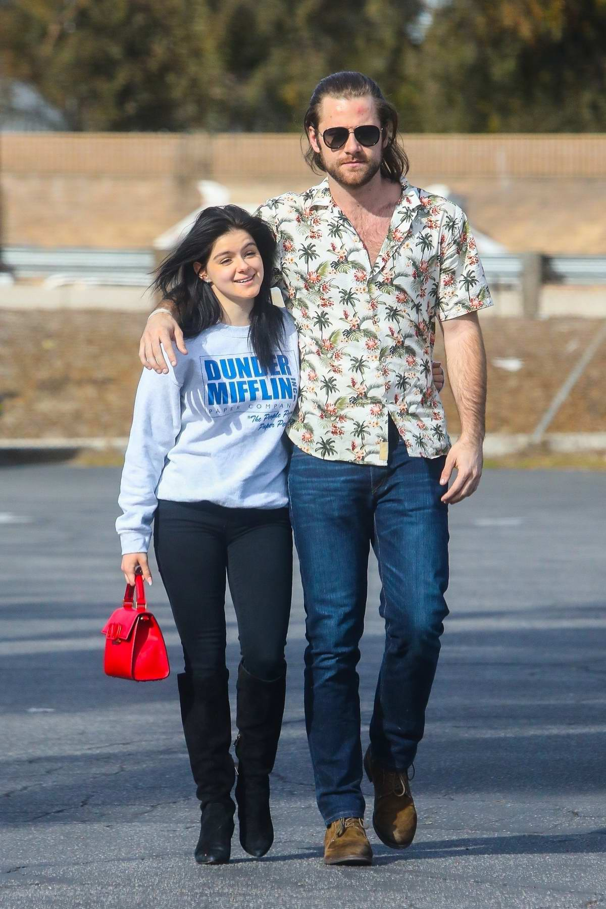 Ariel Winter and new boyfriend Luke Benward wrap their arms around each other during a lunch date at Patys Restaurant in Los Angeles