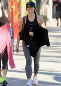 Ashley Greene looks fit in a tank top and leggings as she leaves her yoga class in Studio City, California