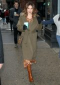 Ashley Tisdale bundles up in a green overcoat with brown boots as she visits Build Series in New York City