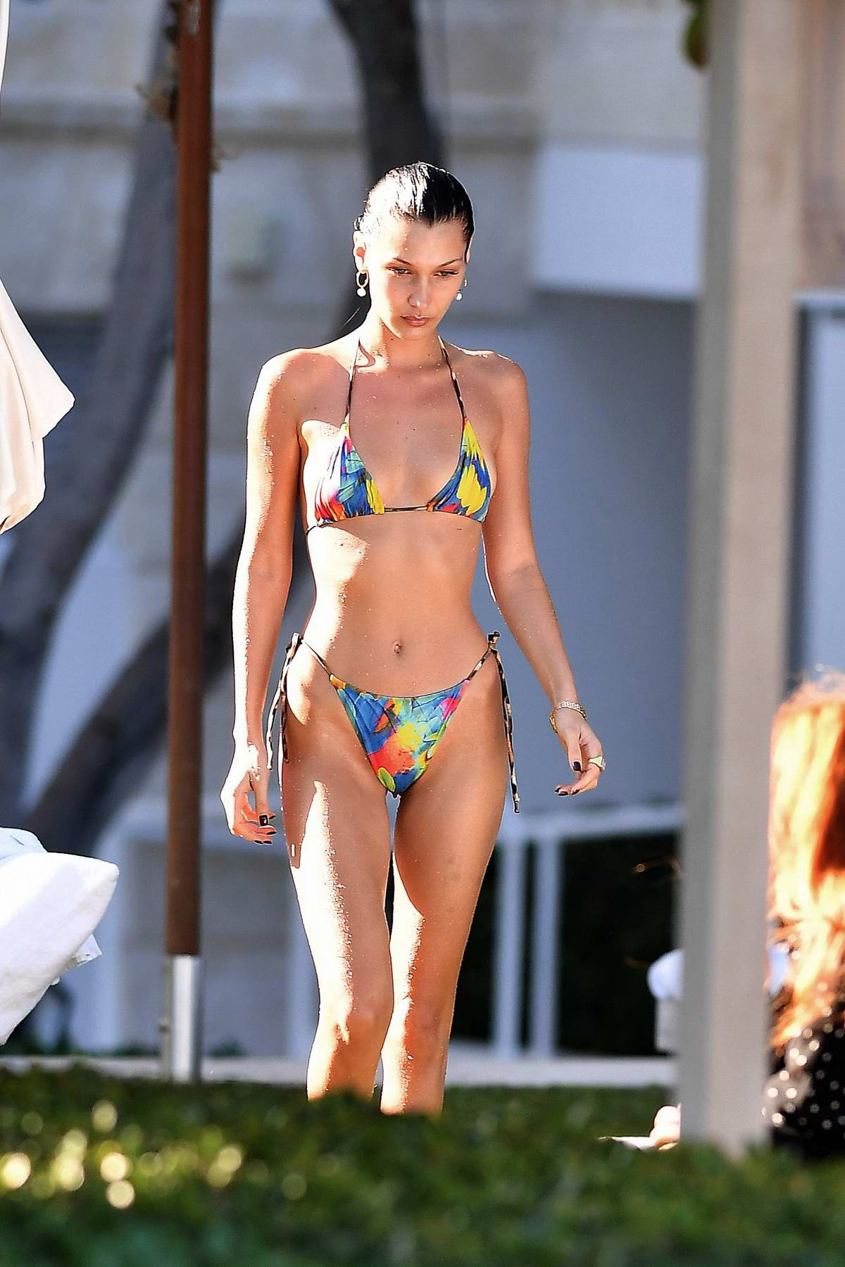 Bella Hadid stuns in a colorful bikini while relaxing by the pool in Miami Beach, Florida