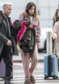 Bella Thorne keeps it comfy in a lavender fleece with matching sweatpants and animal print slippers as she arrives to fly out of London, UK