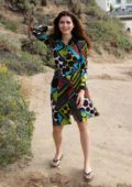 Blanca Blanco wears a multi-colored graphic print dress as she goes for a hike in Malibu, California