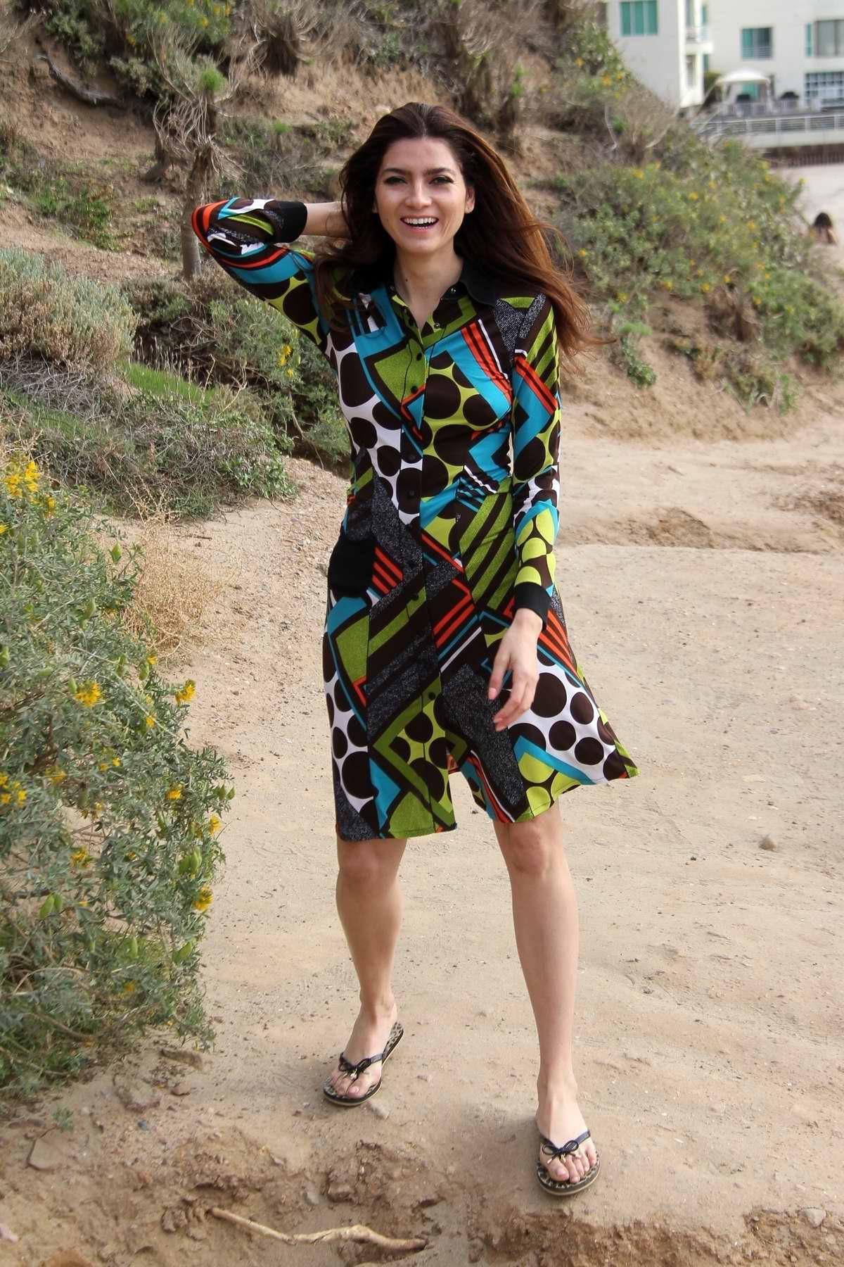 Blanca Blanco wears a multi-colored graphic print dress as she goes for a hike in Malibu, California