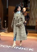 Camila Cabello seen wearing a plaid trench coat as she leaves her hotel in New York City