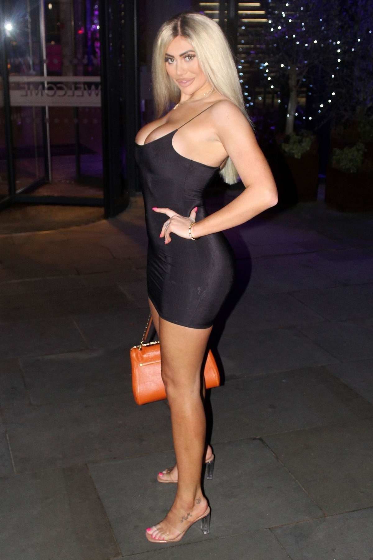 Chloe Ferry wears a tight black mini dress during a night out at BLVD bar in Manchester, UK