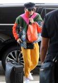 Daisy Ridley sports a colorful ensemble as she arrives at LAX Airport in Los Angeles
