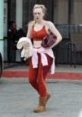 Dakota Fanning sports red leggings with matching workout top as she hits the gym in Los Angeles