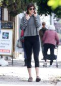 Dakota Johnson sports a grey hoodie and black leggings as she leaves her yoga class in Studio City, California