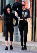 Dakota Johnson wears a Chicago Bulls Tee and black leggings as she hits the gym with Addison Timlin in Los Angeles