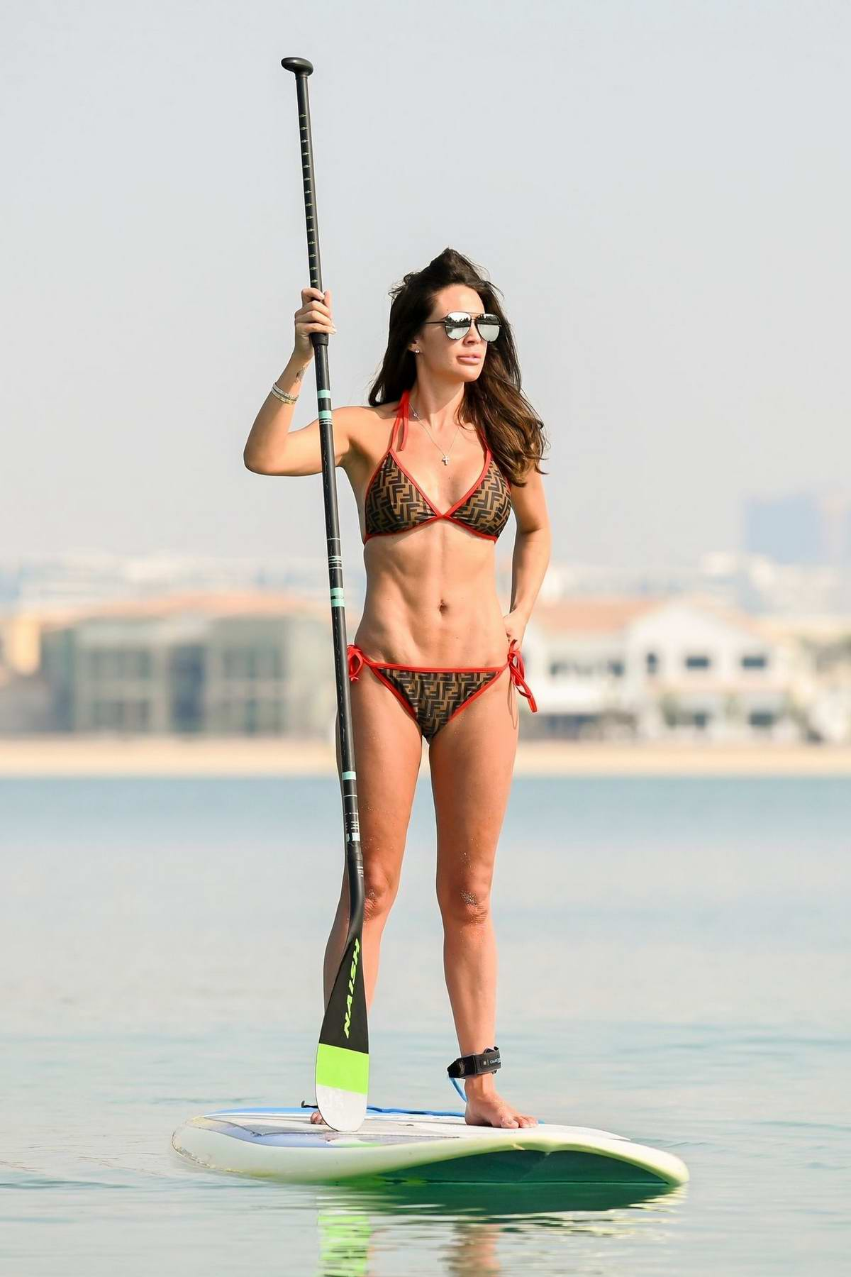 Danielle Lloyd seen wearing a FENDI bikini while paddle boarding in the sea in Dubai, UAE