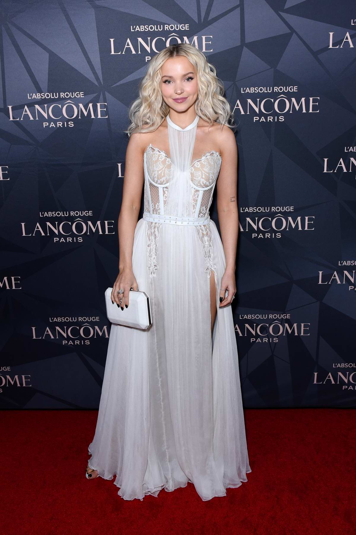 Dove Cameron attends Lancôme x Vogue L'Absolu Ruby Holiday Event at Raspoutine in West Hollywood, Los Angeles