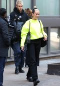Dua Lipa stands out in a bright neon sweater as she leaves her apartment with Anwar Hadid in New York City