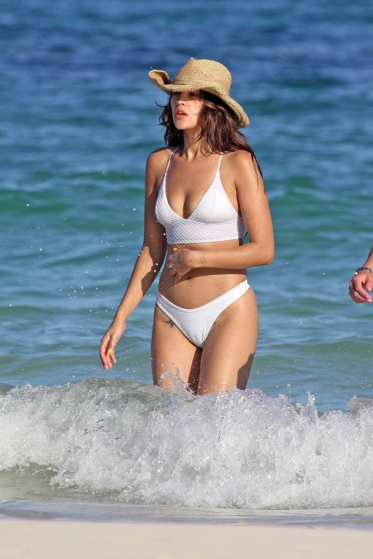 Eiza Gonzalez sports a white bikini while enjoying the beach with Luke Bracey in Tulum, Mexico
