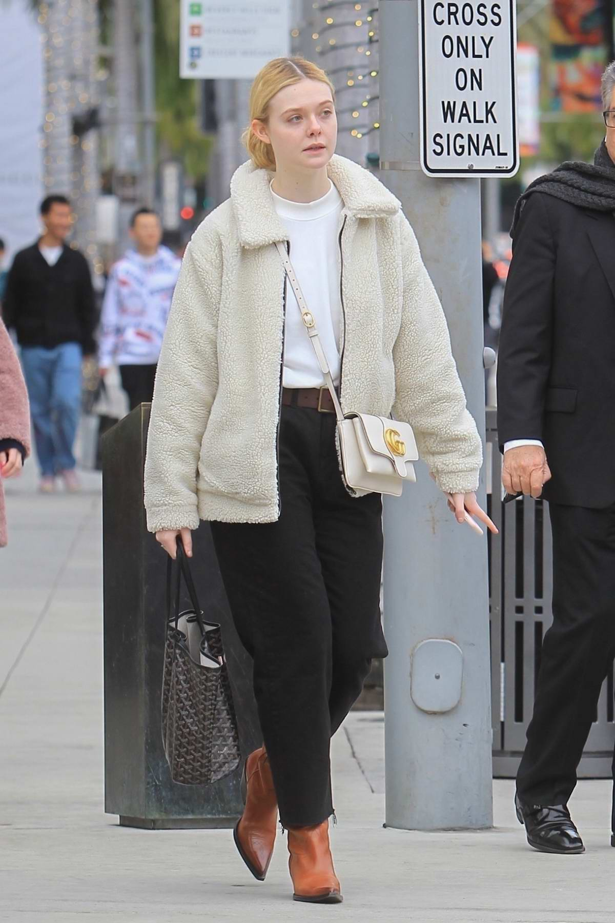 Elle Fanning rocks an off-white teddy jacket while out for some last-minute Christmas shopping in Beverly Hills, California