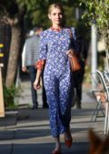 Emma Roberts looks pretty in a blue floral print dress as she grabs lunch at Blue Bottle Coffee Shop in Los Feliz, California