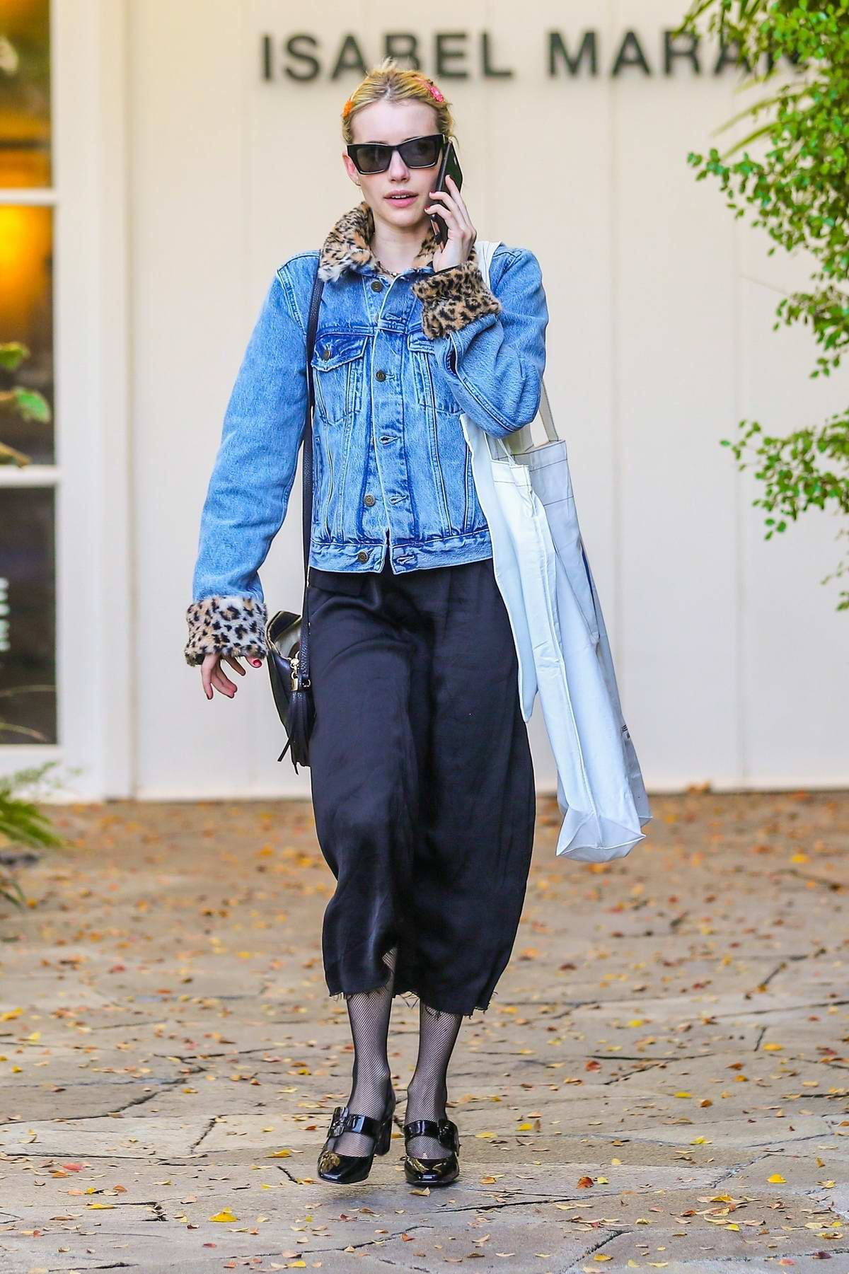 Emma Roberts looks stylish in a denim jacket while shopping on Melrose Place in Beverly Hills, California