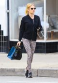 Emma Roberts seen wearing a black jacket and animal print leggings while out shopping in Studio City, California