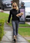 Emma Roberts steps out to grab some food to go on a rainy day in Los AngelesEmma Roberts steps out to grab some food to go on a rainy day in Los Angeles