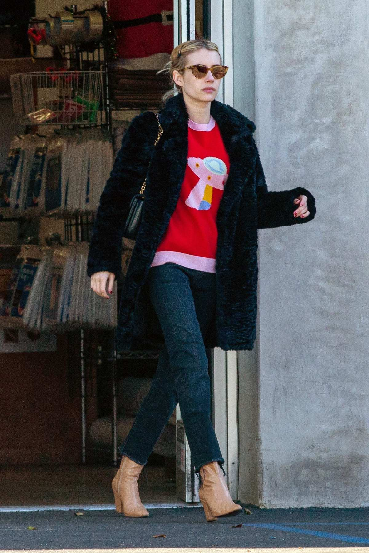 Emma Roberts stops at a store to ship some gifts on Christmas Eve while out running errands in Los Feliz, California