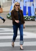 Emma Roberts wears a brown jacket and blue jeans for a shopping outing in Beverly Hills, Los Angeles