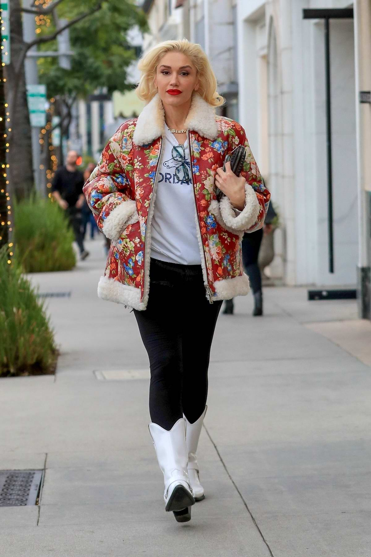 Gwen Stefani looks lovely in a fur-lined floral print jacket while out for some Christmas shopping in Beverly Hills, California