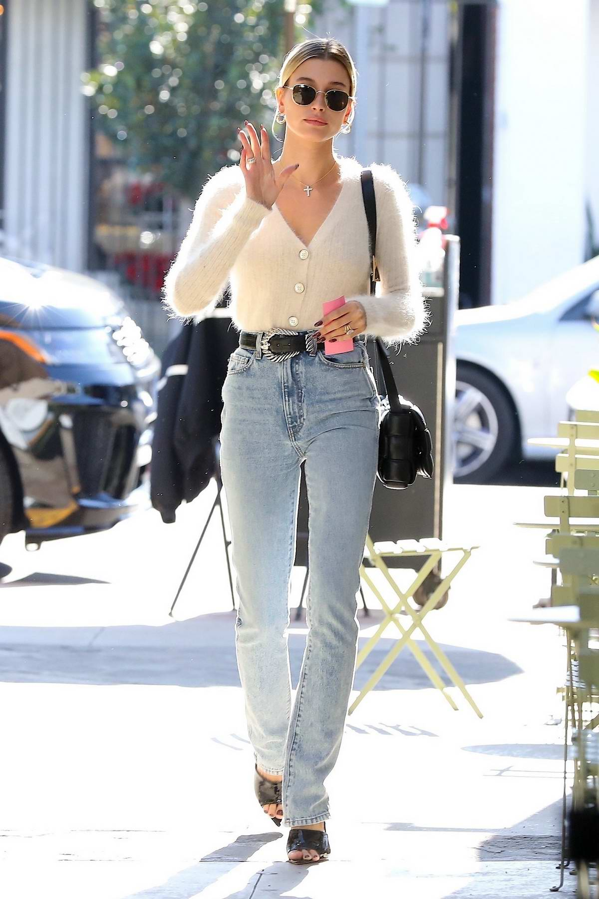 Hailey Bieber looks stylish in a white cardigan as she visits Nine Zero One salon in Los Angeles